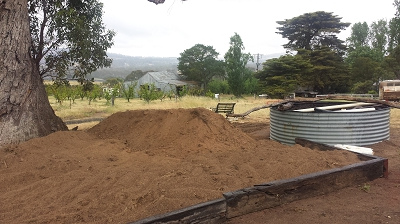 Filling new beds with soil at our farm shop to create a native garden
