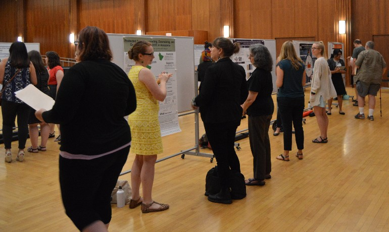 Attendees interact during poster session