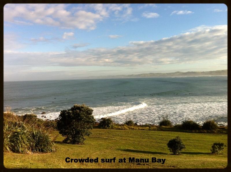 Surfers at Manu Bay