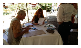 Jane Griffiths signing copies of her books.