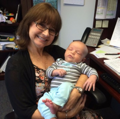 AmaTerra President wondering if she can make a break for it with the cute baby...