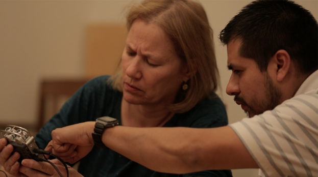 Debby Bussel and Roberto Nava examine an audio recorder at Storymakers training, March 2016 | Video still by Ian McClerin