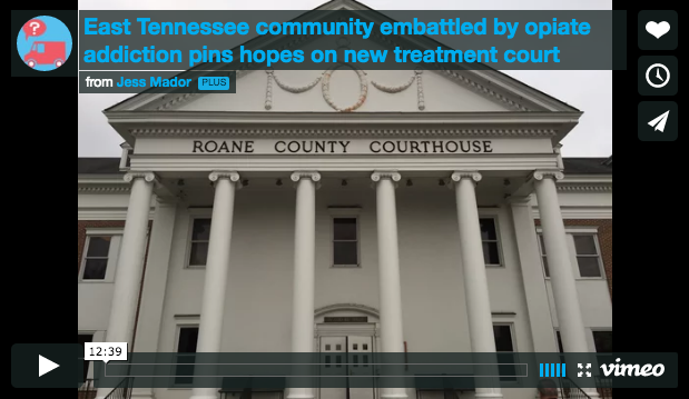 """A large, granite building with pillars looms below the title """"Roane County Courthouse"""" with a """"play video"""" button."""
