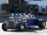 Custom Ford has four Weiand blowers and Four Holley Carbs