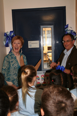 Head of School Debbi David and Art Teacher Rick Danenberg cut the ribbon to the brand new art room