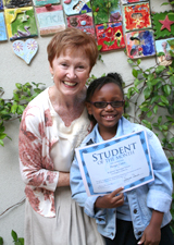 Head of School Debbi David poses with one of our many Student of the Month Award Receivers