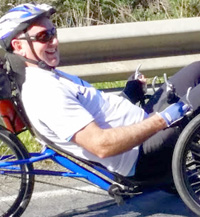 Tim Sanders on a specially designed recumbent trike the National Disability Insurance Scheme funded