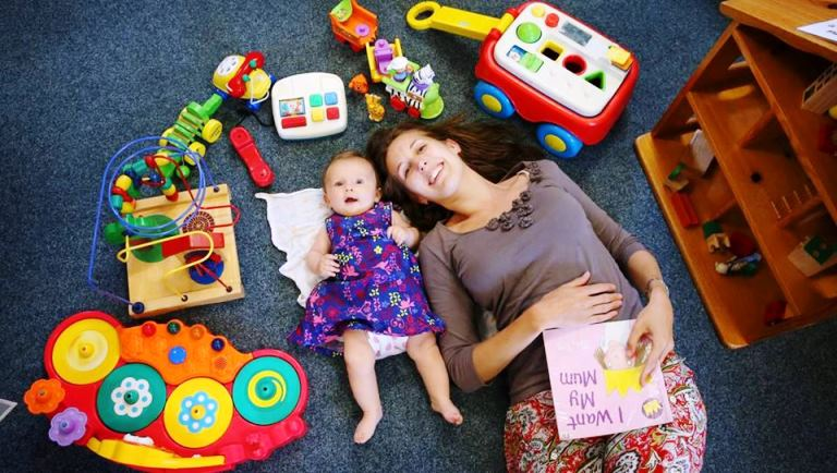 Newcastle Toy Library President, Sally Finnie and her daughter, Juliet Rose, enjoy all the toy library has to offer.