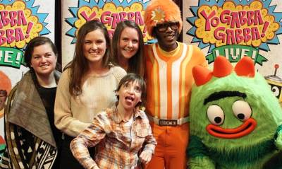 From left, Frank's sisters, Hannah and Rowena, his support worker, Kate Macintosh, DJ Lance, Brobee and Frank, at a recent Yo Gabba Gabba concert
