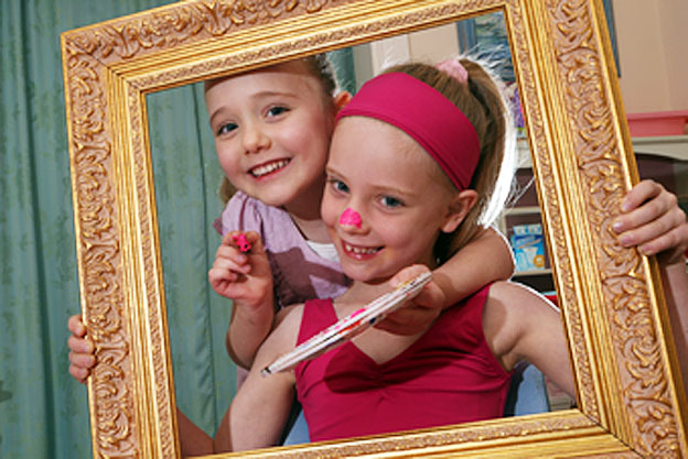 Budding artist Ella Noble, 4, left, practises her skills with sister Ava, 6, at their Adelaide home.