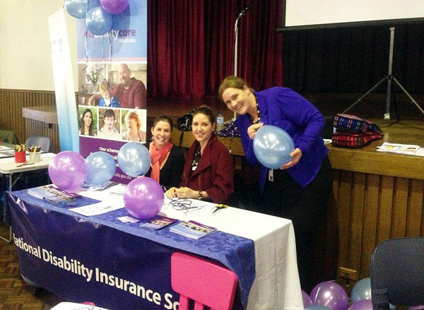 photo of 3 of the Barwon trial site staff preparing for the children's expo.