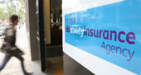 Thumbnail image of a person walking into a NDIA office.