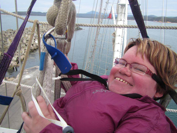 Heather Anderson sits high atop the masthead of the tall ship the Lord Nelson.