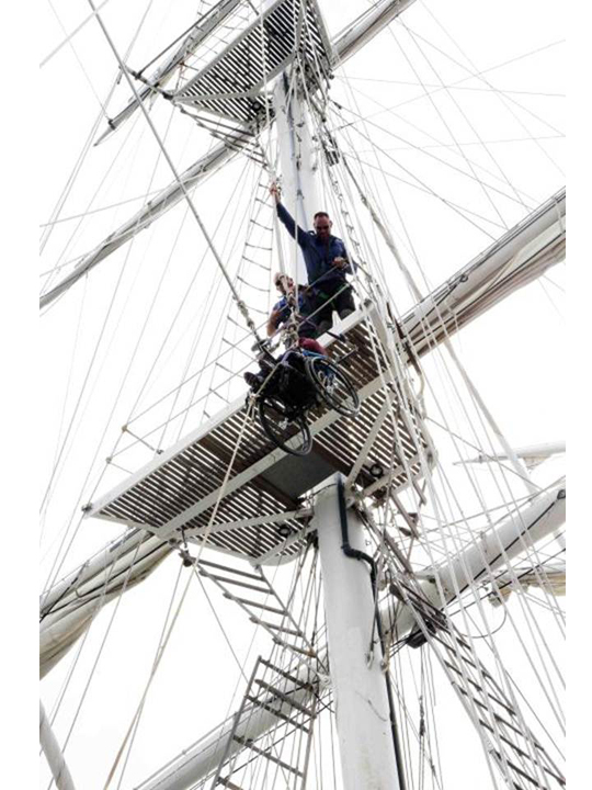 Now that's access: Heather Anderson is hoisted to the masthead.