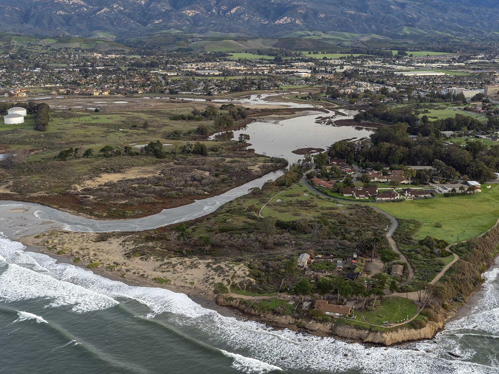 Aerial photo looking north over Devereux Slough and NCOS on January 20 - note the waves and high tide flowing into the slough mouth at the left side of the photo.