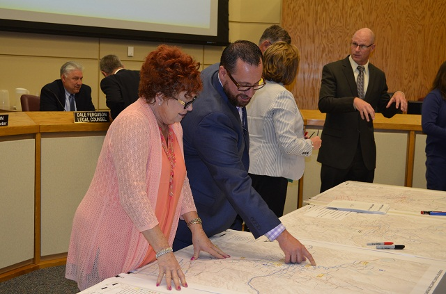 Commissioners view a map during the June Board meeting