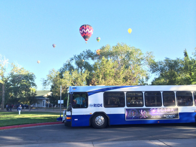 Bus with hot air balloons