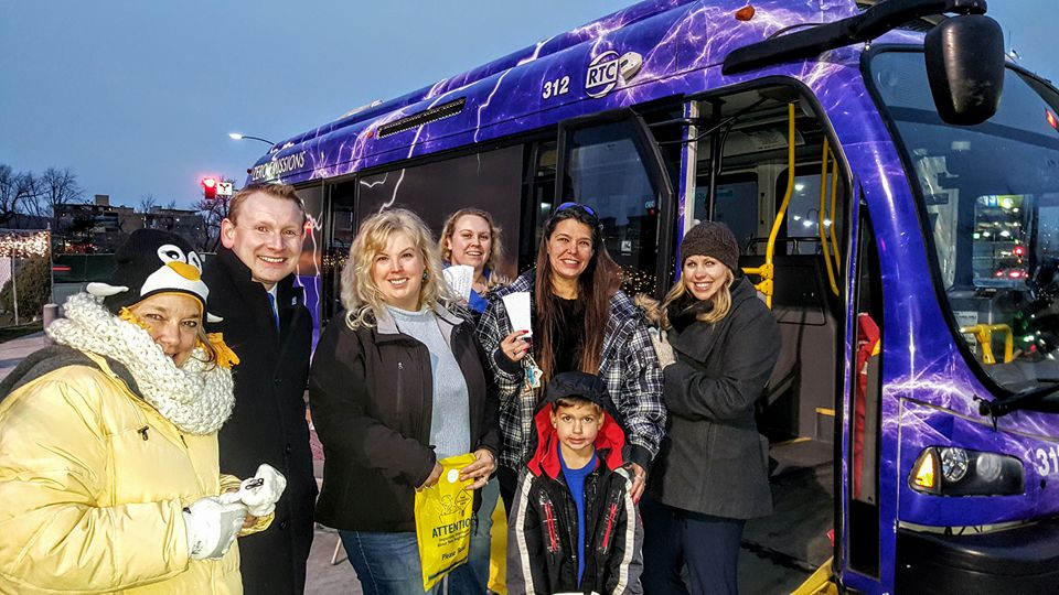 RTC Staff and Members of the Public Pose by a Bus