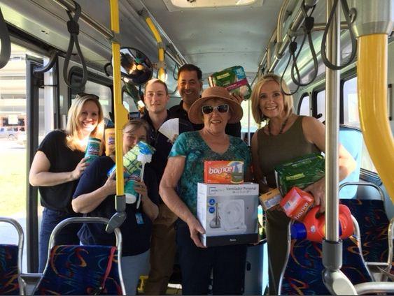 Neoma Jardon on a bus holding donations