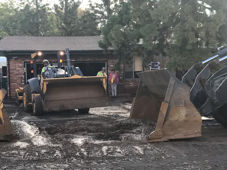 Crews use dozers to clean up mud