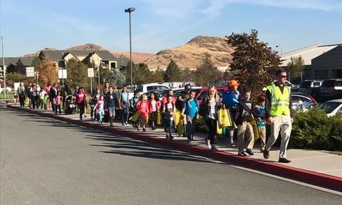 Students walk along the sidewalk