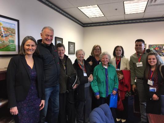 Seniors pose with elected representatives