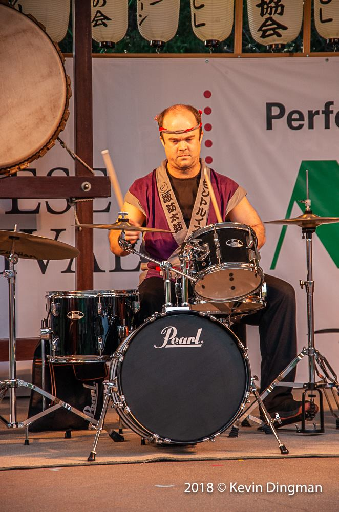 Jeremy plays western drums during Lion Chant (Image Credit: Kevin Dingman)