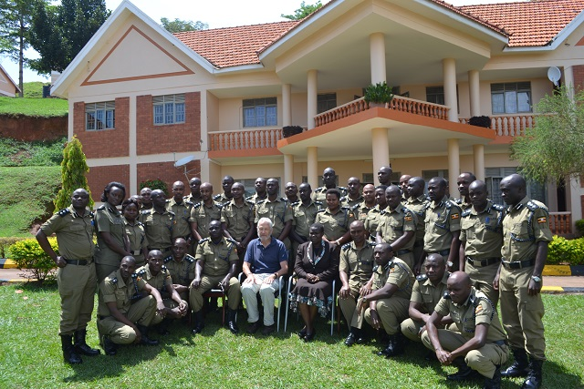 Professor Geoffrey Harris with the Ugandan police officers.
