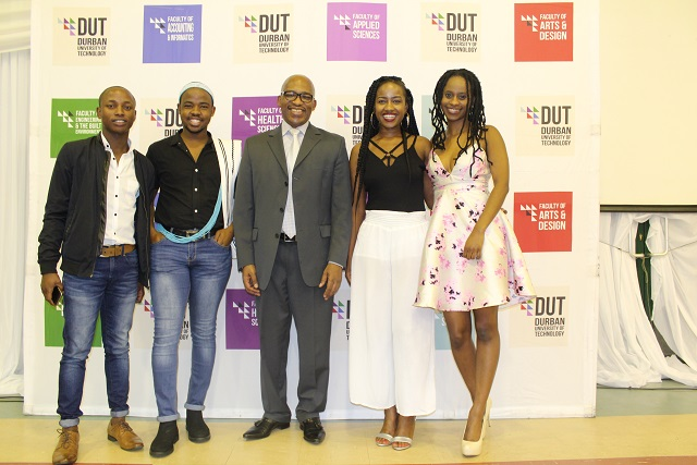 Professor Thandwa Mthembu with RadioDUT Presenters during the WoW Gala Dinner.