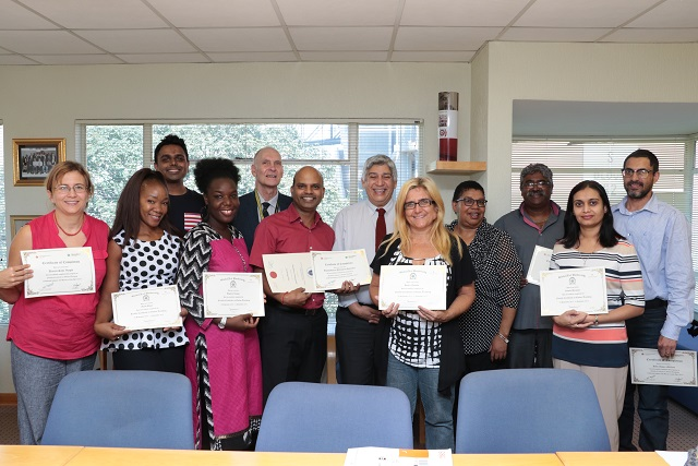 The DUT FCOT and e/Merge certificate recipients with Prof Bawa and Prof Gwele.