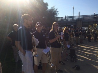 Alumni of the Pitt Band marching gathering at a pre-game concert outside Heinz Field.