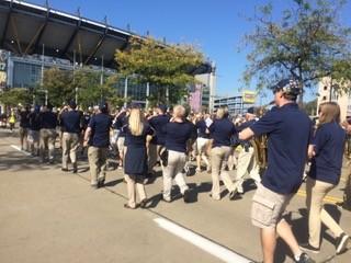 Alumni of the Pitt Band marching toward Heinz Field at Alumni Band Day 2017.