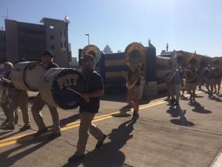 Alumni of the Pitt Band marching toward Heinz Field.