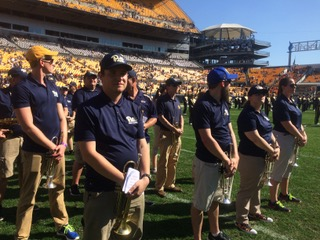Alumni of the Pitt Band take the field during halftime at Alumni Band Day 2017.