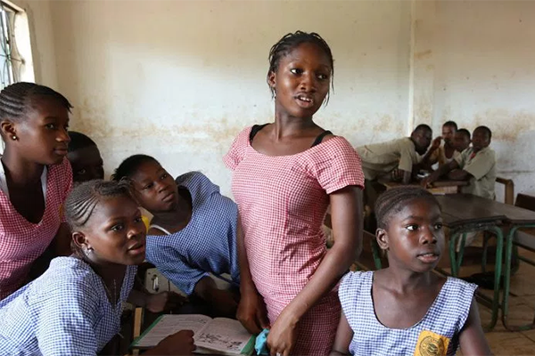 school aged girls reading in Africa