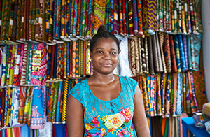 Woman standing in a fabric shop in Ghana