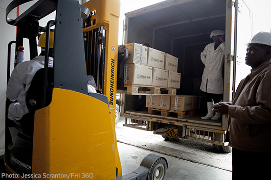 Workers loading a truck