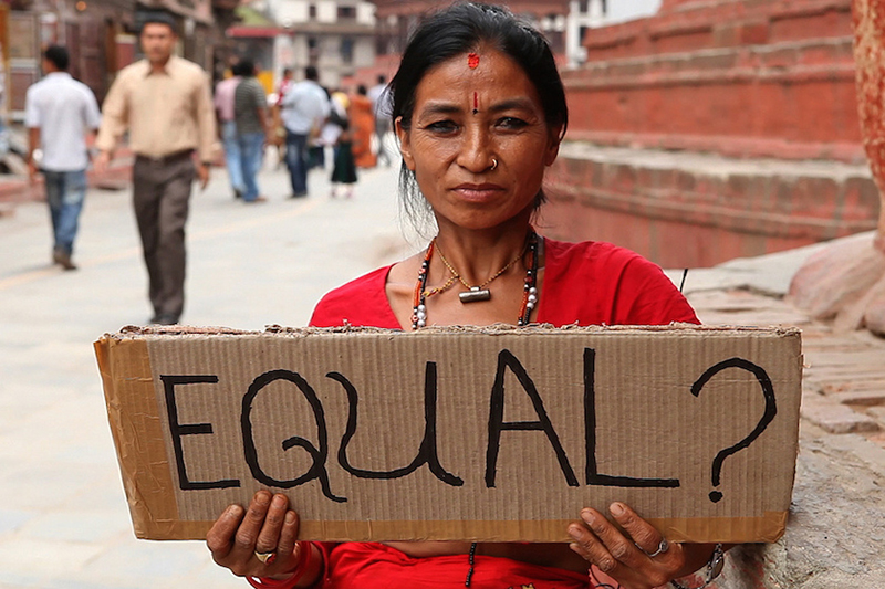 """Woman holding """"Equal?"""" sign"""