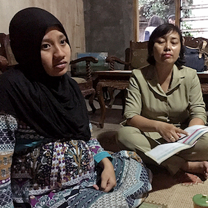 Pregnant woman and midwife