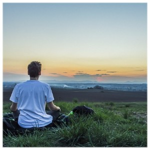 Picture of man meditation at sunset