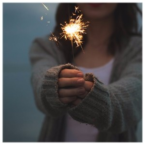 Image of Woman Holding a Sparkler