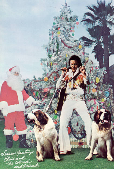 Elvis Presley, two St Bernards, and Colonel Tom Parker as Santa