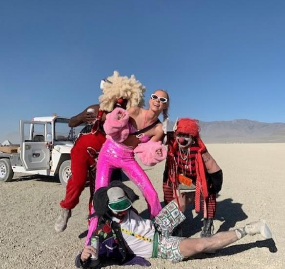 Krusty Klowns photobomb instafluencers at Burning Man