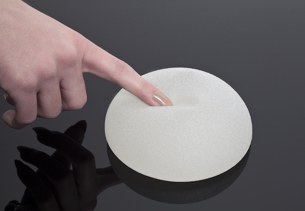 Breast implant with a textured surface