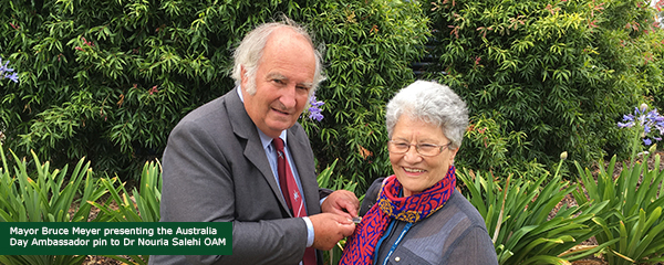Mayor Bruce Meyer presenting the Ambassador pin to Dr Nouria Salehi OAM