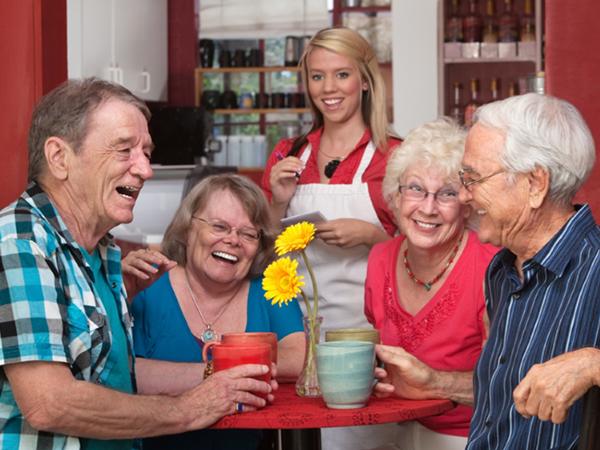 Group of senior citizens having coffee