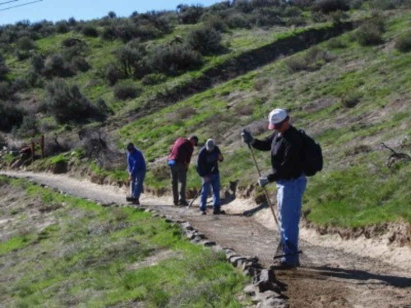 People working on the trail