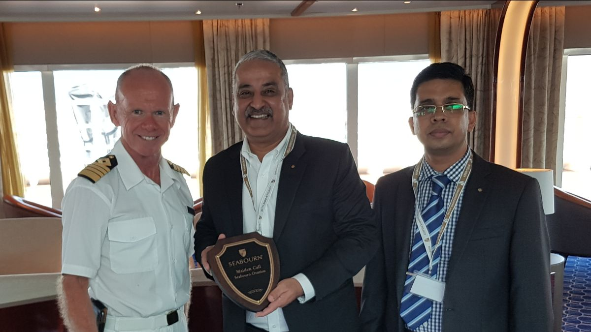 Captain Andrew Peddar, Master of MV Seabourn Oviation, presents a plaque to Rajesh Moorjani, General Manager of GAC Ras Al Khaimah (middle) and Sathik Ali, Shipping Manager of GAC Ras Al Khaimah (right) during the vessel's call at the new Ras Al Khaimah Cruise Terminal