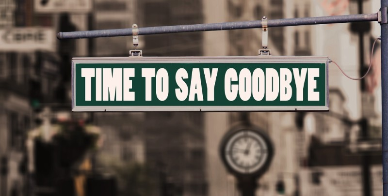 Street sign with words Time to Say Goodbye in white font on green background