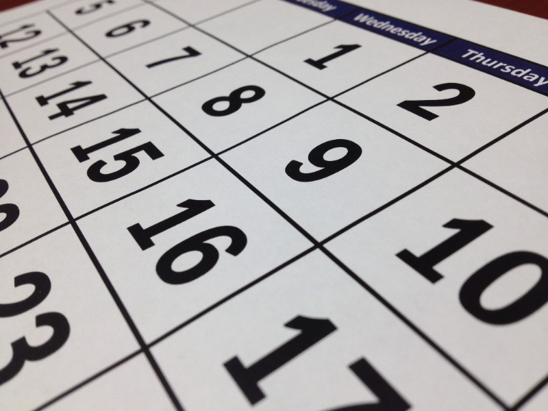 Close up shot of a calendar, angled so the header and most of the body is visible